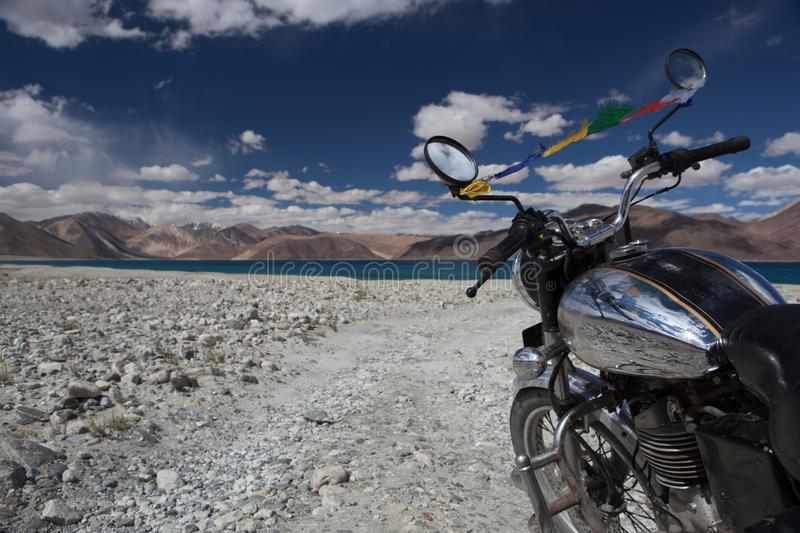 Travelling by bike along high altitude Pangong. royalty free stock photo