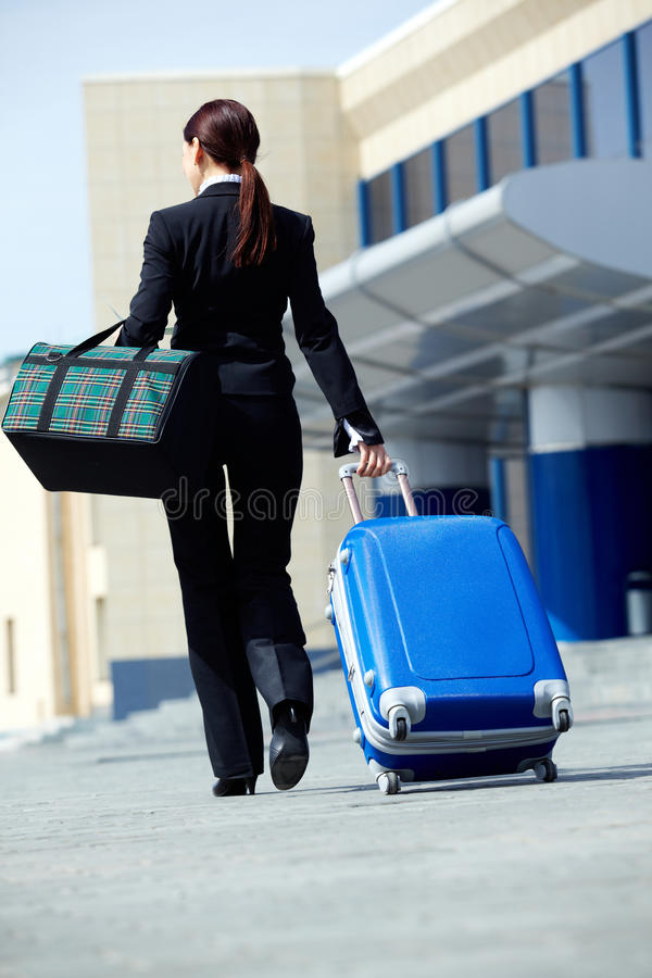 Download Travelling businesswoman stock image. Image of female - 21474303