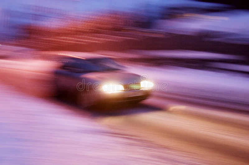Travelling Car. A abstract blur image of a car travelling at night stock photos
