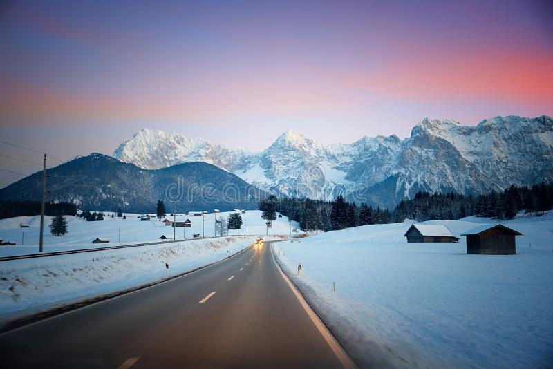Travelling on the country road from garmisch to mittenwald, with view to karwendel mountains. Travelling on the country road from garmisch to mittenwald beside royalty free stock photos