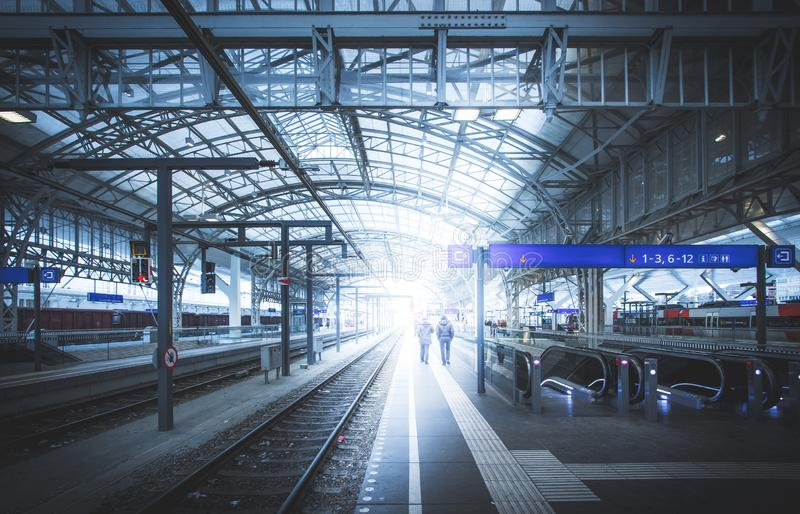 Travelling scene on a train station, public transport: rail platform or track. Travelling scene on train station, rail platform or track public transport journey royalty free stock image