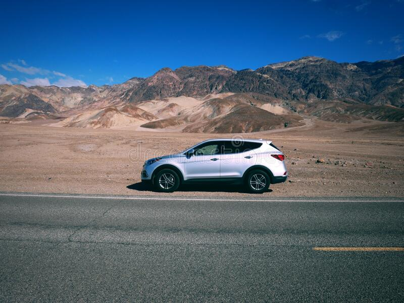 Travelling a silver SUV around Death Valley - US trip stock images