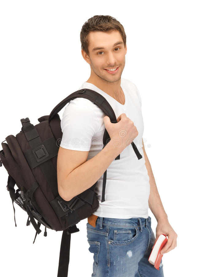 Travelling student. Bright picture of travelling student with backpack and book stock image