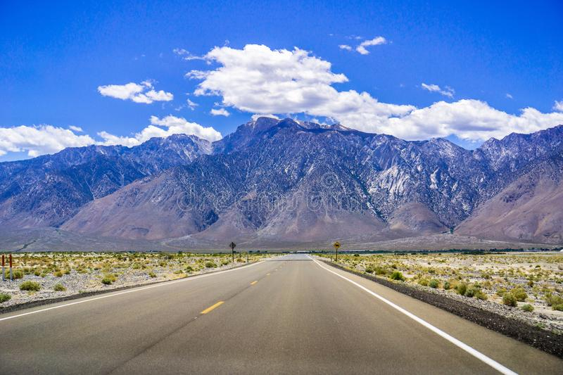 Travelling towards the Sierra Mountain Range at the end of spring; snow still visible on the peaks; California stock photo
