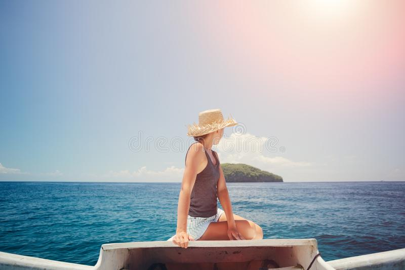 Travelling woman floating on the boat. Near the island royalty free stock images