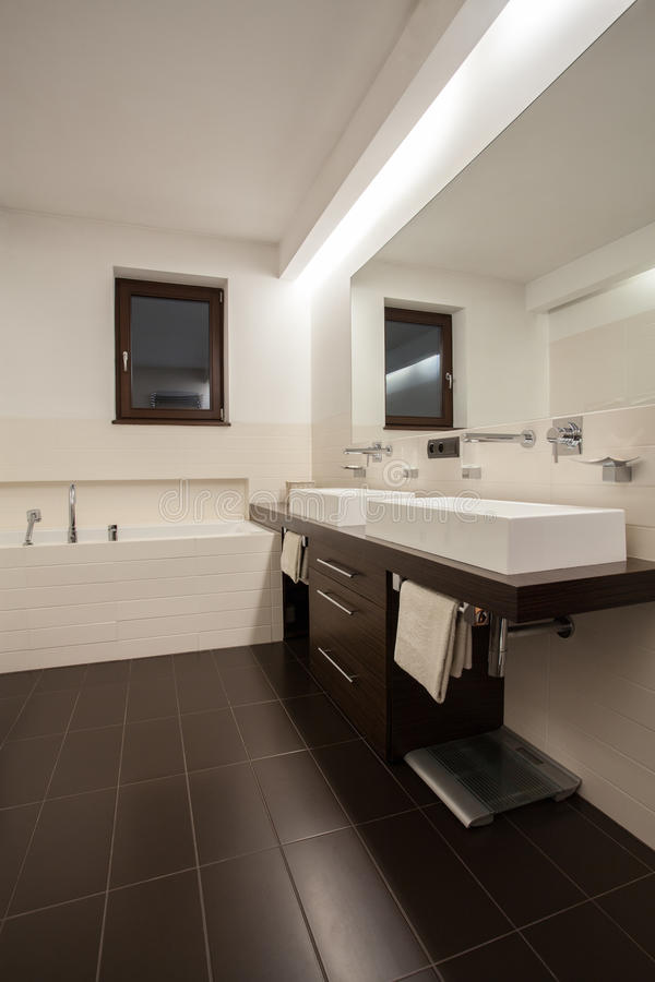 Travertine house - beige bathroom. With brown accessories stock photos