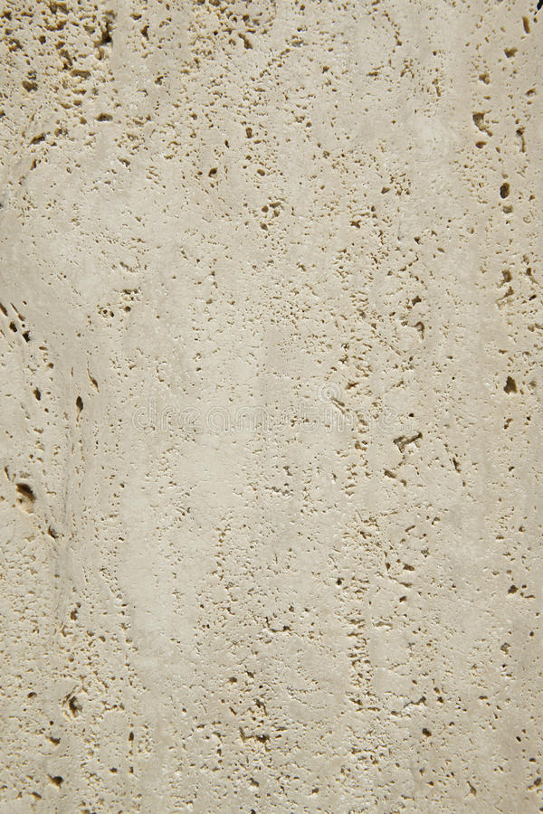 Travertine marble surface detail in vertical format royalty free stock photos
