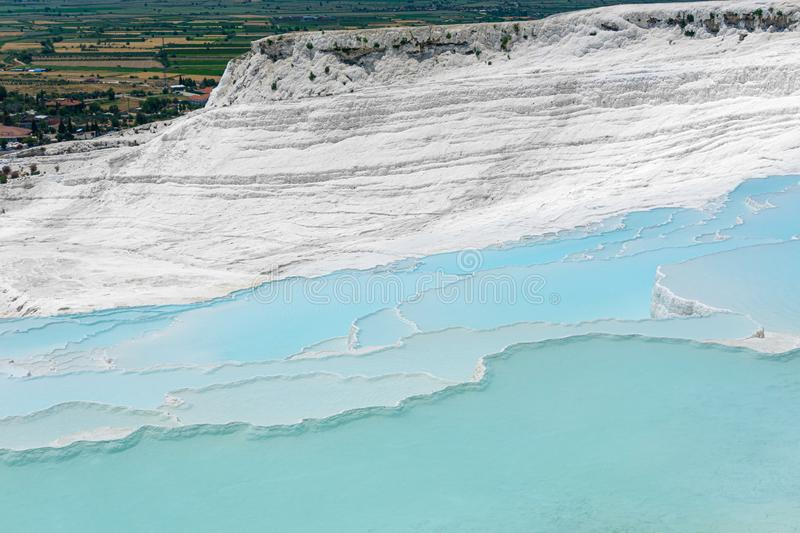 Travertine pools and terraces view from Pamukkale, Denizli, Turkey. Cotton castle at sunny bright day.  royalty free stock photo