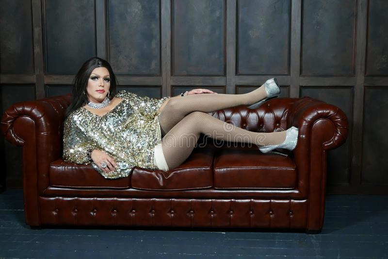 Travesty-diva. The concept of a transvestite. Man-actor turns into a woman. he is posing for the camera stock photography
