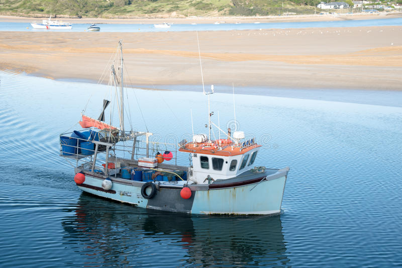 Trawler. Fishing boat arrives in the port of Padstow at the Camel estuary in north Cornwall stock image