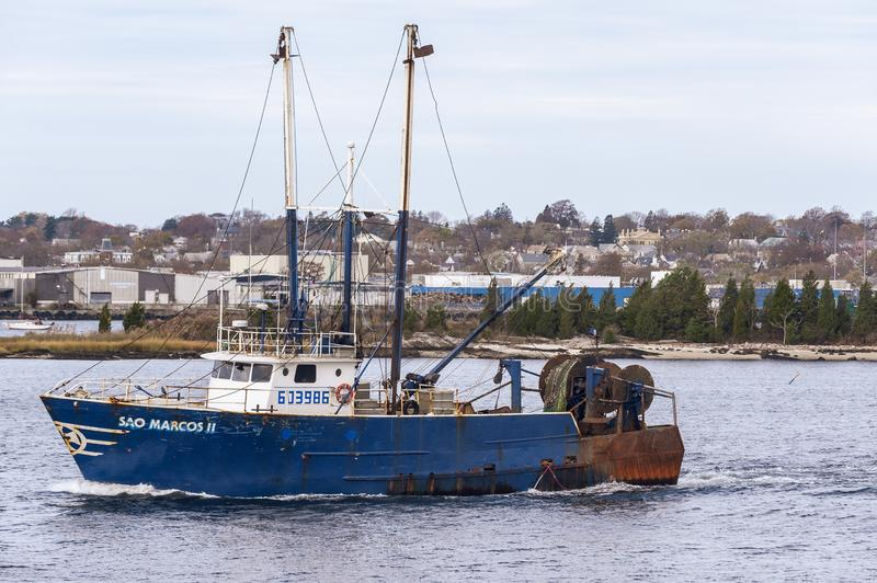 Trawler Sao Marcos II going fishing. New Bedford, Massachusetts, USA - November 7, 2019: Commercial fishing boat Sao Marcos II crossing Acushnet River with New stock image
