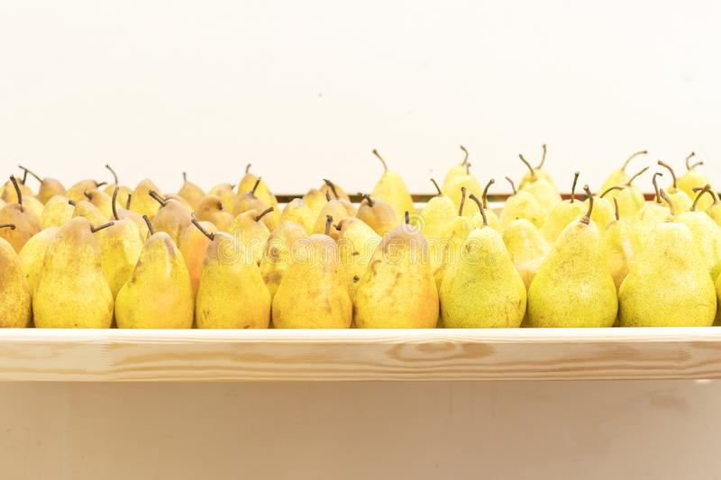 A tray with beautiful ripe pears.  royalty free stock photos