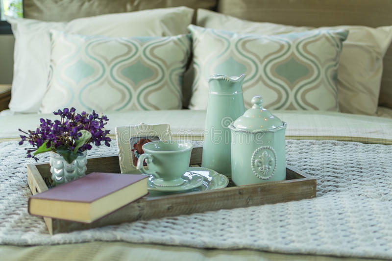 Tray with book,tea set and flower on the bed. Decorative tray with book,tea set and flower on the bed stock image