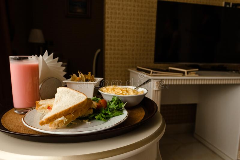 Tray with breakfast on a bed in a hotel room royalty free stock images