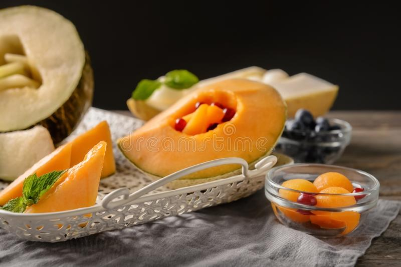 Tray with delicious melon on table royalty free stock photos