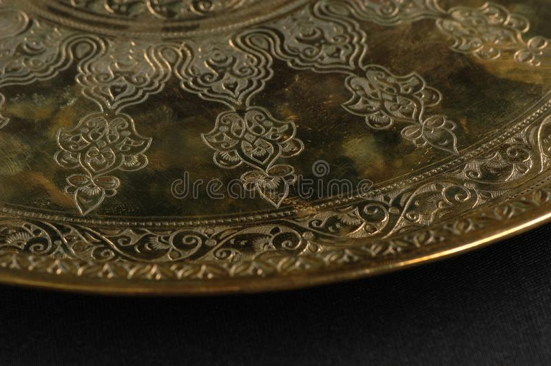 Tray with engraving. Close-up of the tray with Eastern engraving royalty free stock photography