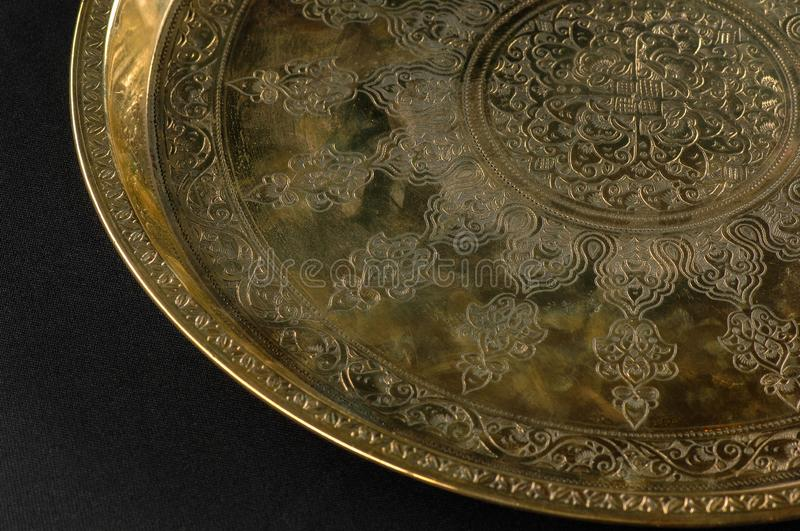 Tray with engraving. Close-up of the tray with Eastern engraving stock photo