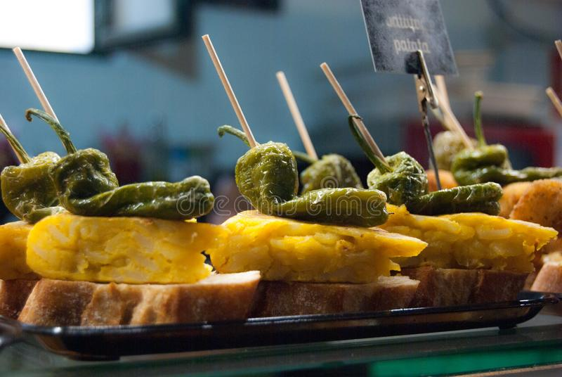 Skewers with green pepper and omelette on slices of bread stock images