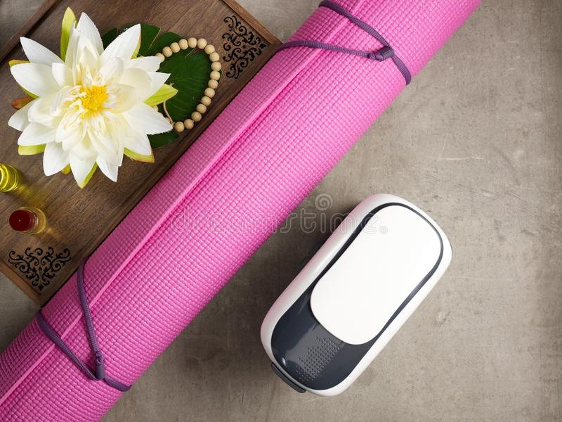 Tray with fragrant stuff for yoga and VR glasses. Closeup on tray with fragrant stuff for aroma yoga, beads, yoga mat and VR glasses laying on the floor stock photos