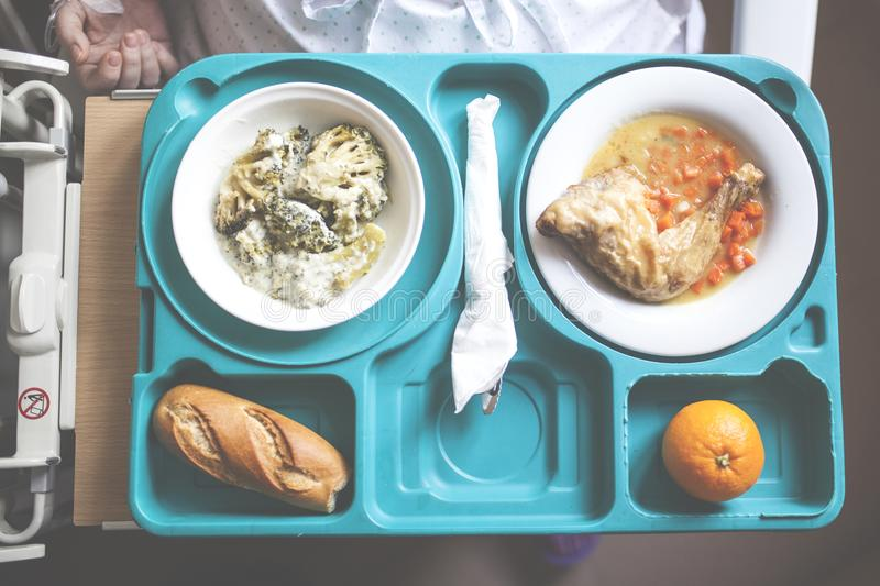 Tray with hospital food. Near the window stock images