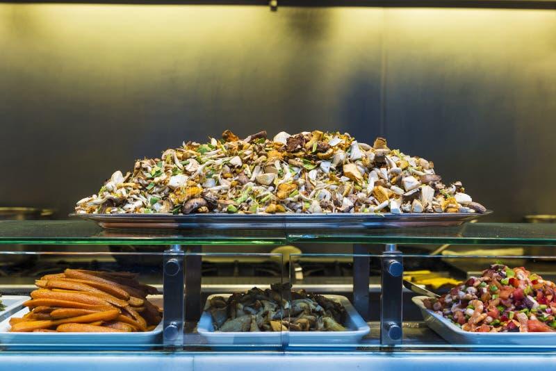 Tray of mushrooms and vegetables in La Boqueria, Barcelona stock image