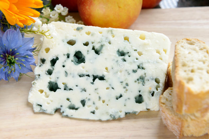 Tray with roquefort with bread and flowers stock photography