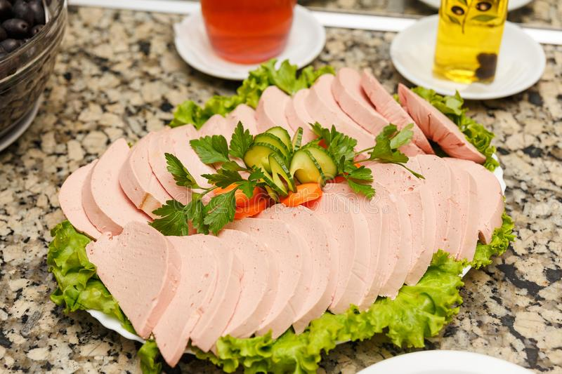 Tray of sliced salami and ham royalty free stock photo