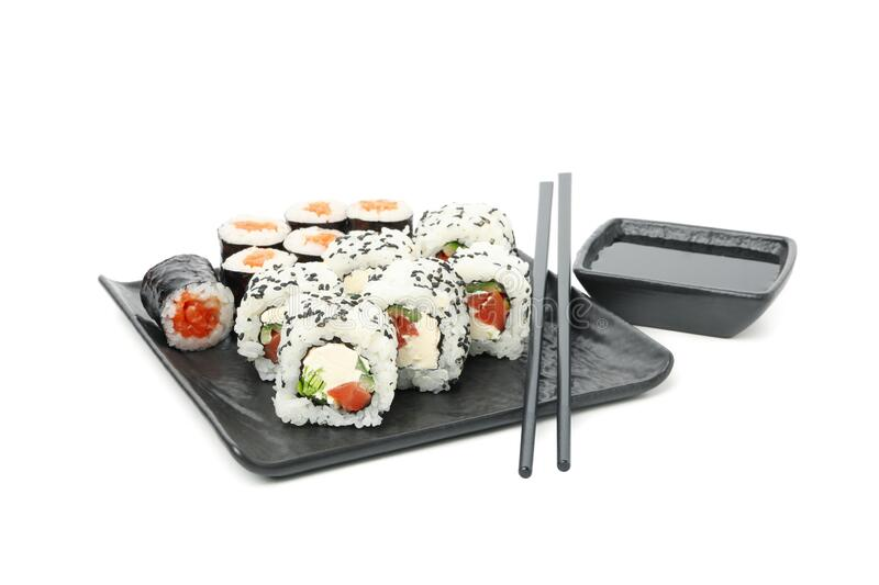 Tray with sushi rolls, chopsticks and soy sauce isolated onbackground. Tray with sushi rolls, chopsticks and soy sauce isolated on white background stock image