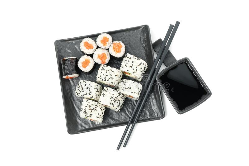 Tray with sushi rolls, chopsticks and soy sauce isolated on background. Tray with sushi rolls, chopsticks and soy sauce isolated on white background royalty free stock photos