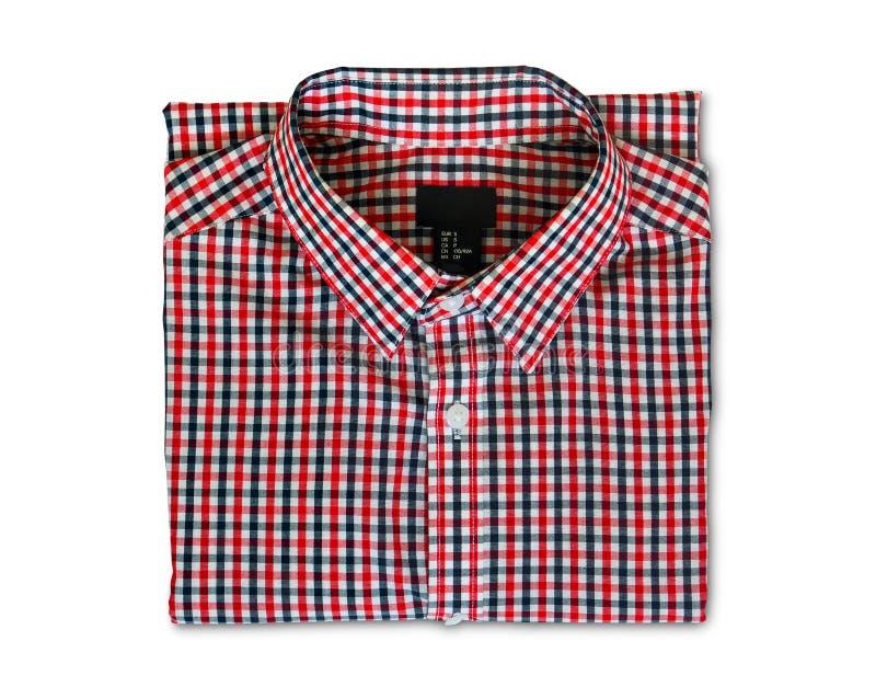 Trayectoria de recortes, vista superior de la camisa de tela escocesa roja y negra doblada del color aislada en el fondo blanco foto de archivo