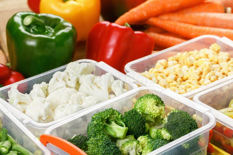 Trays with raw vegetables for freezing. Stocking up for winter storage in plastic containers stock photography