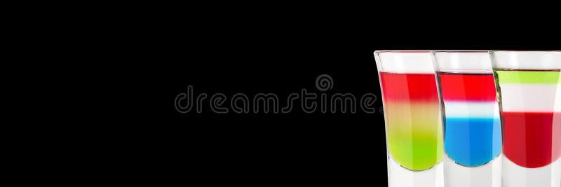 Tre alkoholiserade skott av Kazantip den ryska flaggan och italiensk flagga på en svart bakgrund placera text baner royaltyfri fotografi