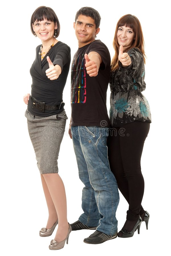 Tre amici felici con i pollici in su immagini stock
