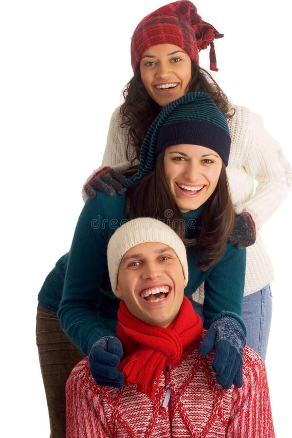 Tre amici felici di inverno fotografia stock