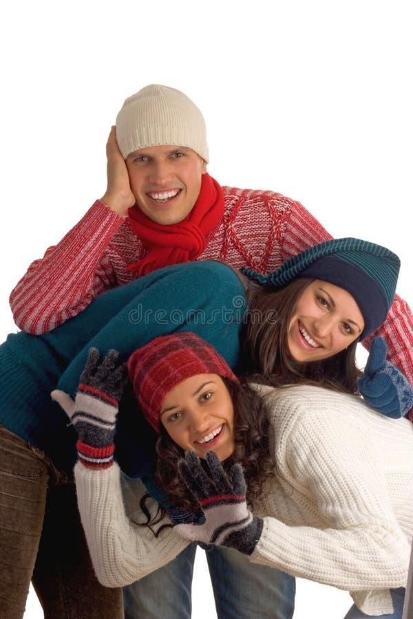 Tre amici felici di inverno fotografie stock