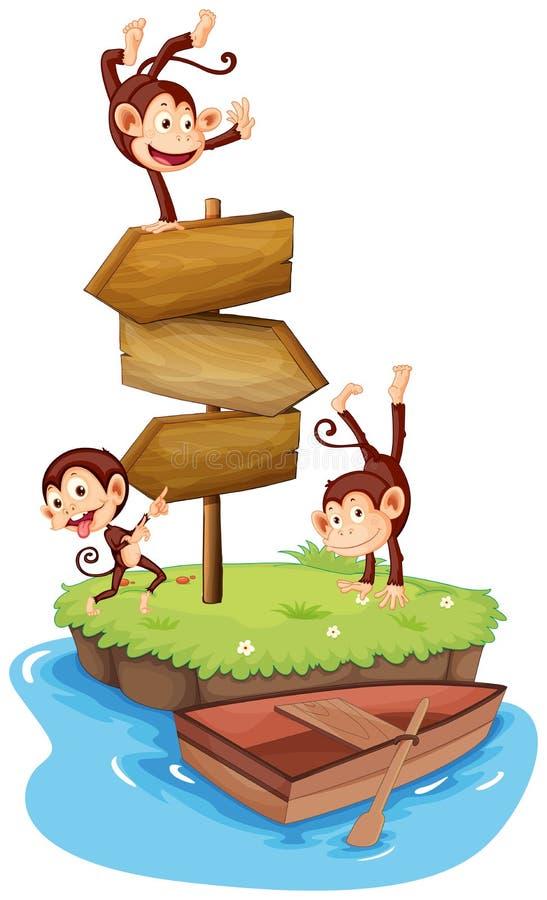 Tre apor och trätecken på ön stock illustrationer