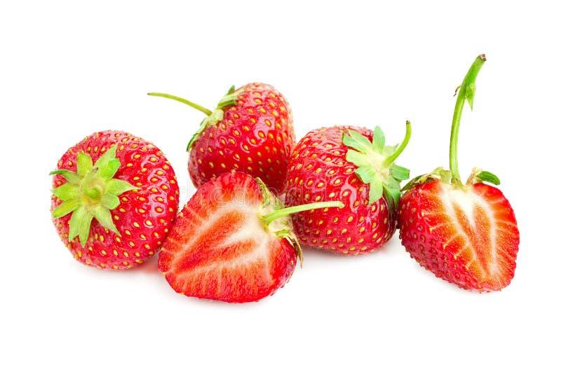 Tre bär av mogna saftiga jordgubbar på den vita tabellen royaltyfria foton