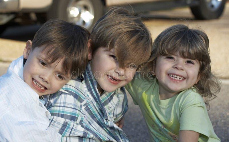 Tre bambini immagine stock