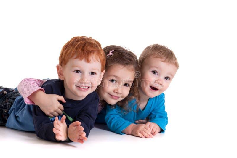 Tre bambini svegli immagine stock