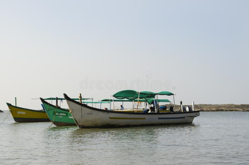 Tre barche sul mare fotografie stock