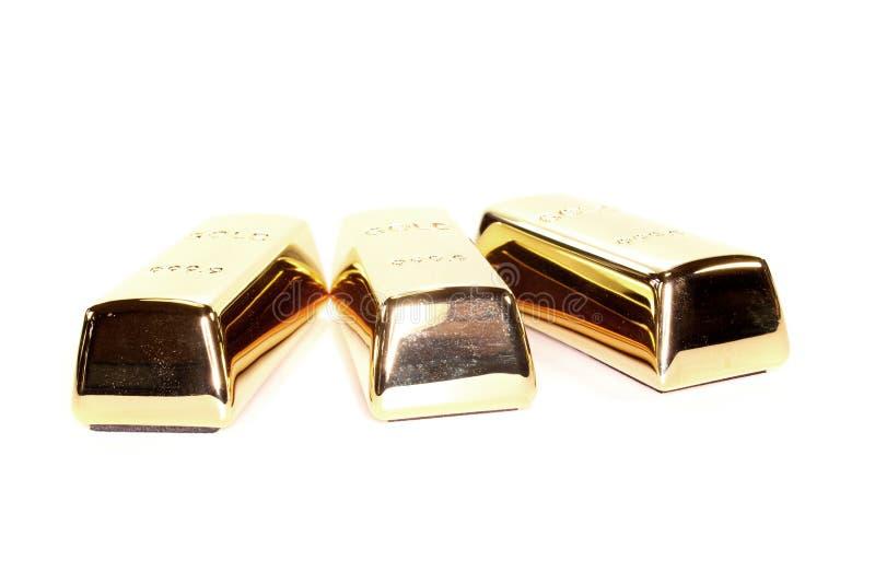 Tre barre di oro fotografie stock libere da diritti