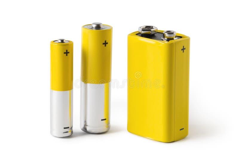 Tre batterie, isolate su fondo bianco fotografia stock libera da diritti