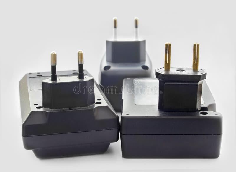 Tre batteriuppladdare royaltyfria foton