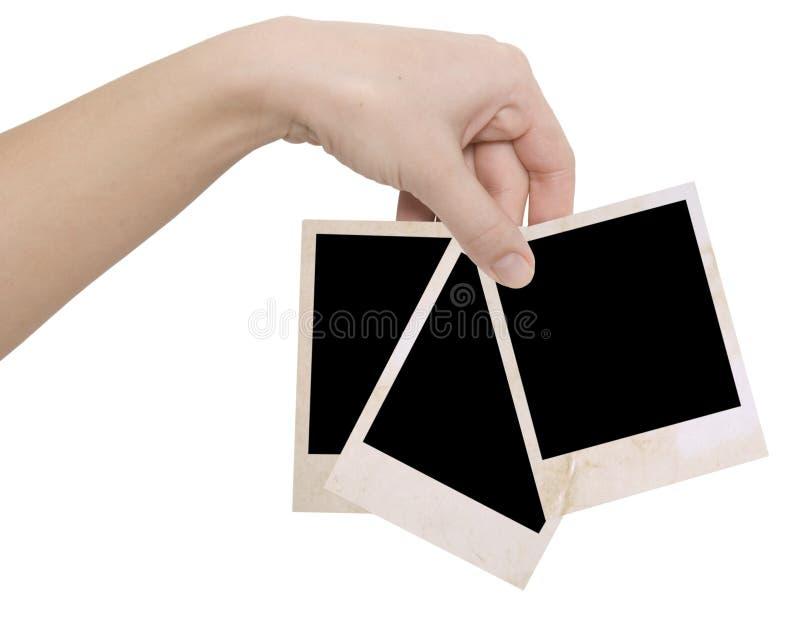 Tre blocchi per grafici della foto in una mano fotografia stock