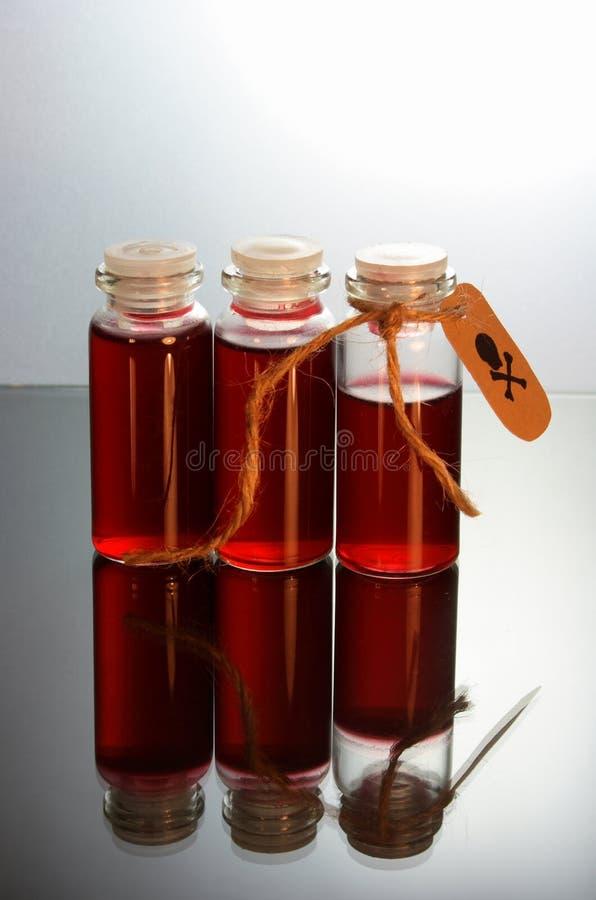 Tre Bottiglie Con Veleno Immagini Stock