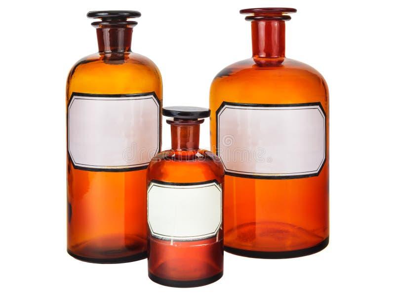 Tre bottiglie d'annata della farmacia fotografia stock