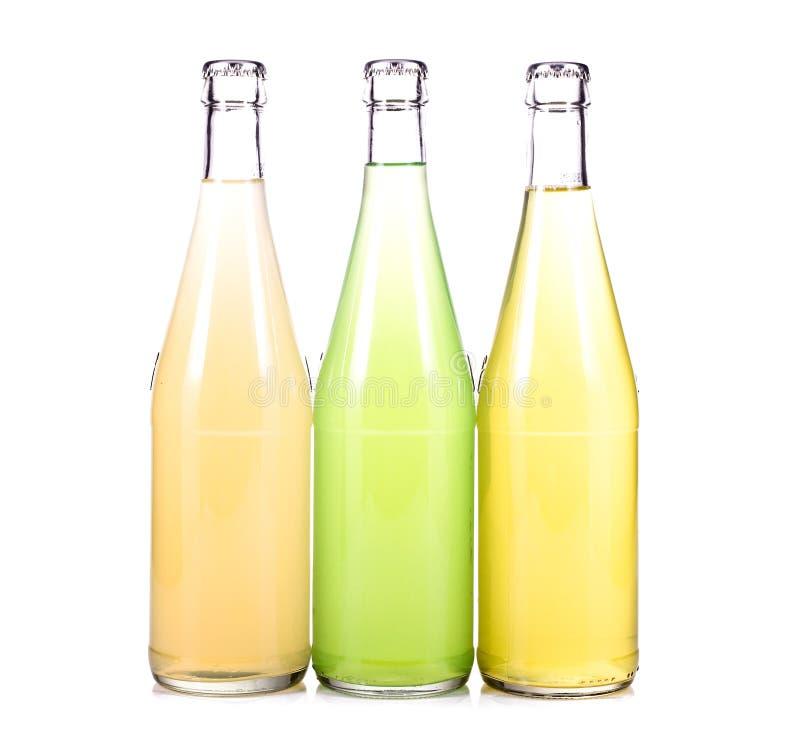 Tre bottiglie di limonata fresca fotografia stock libera da diritti