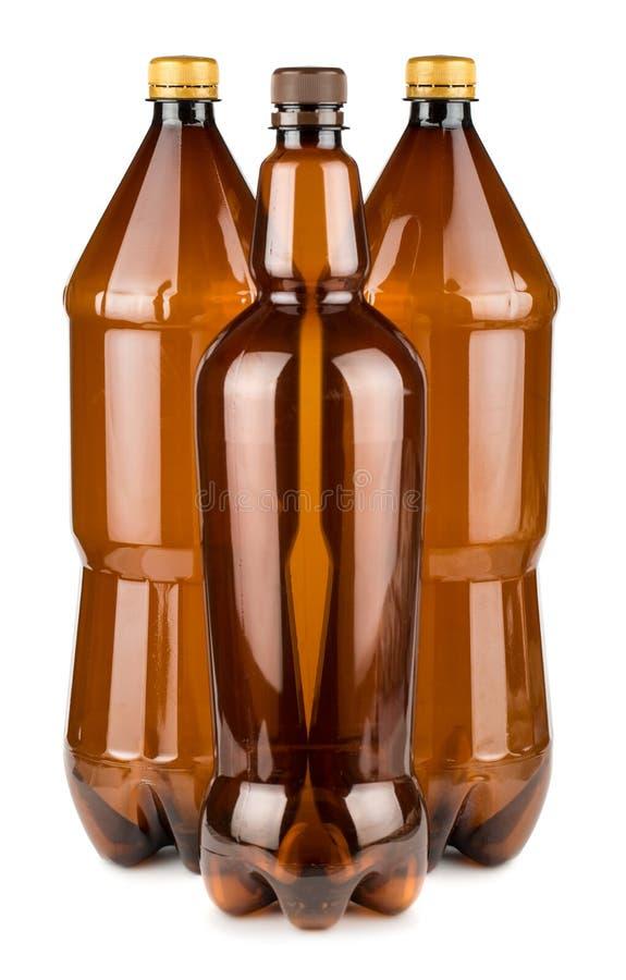 Tre bottiglie di plastica vuote marroni immagine stock