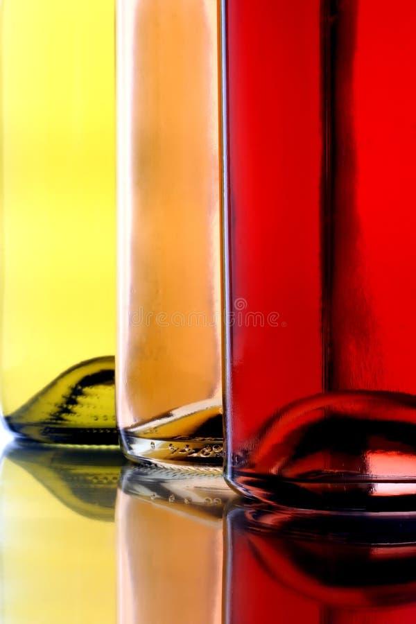 Tre bottiglie di vino immagine stock