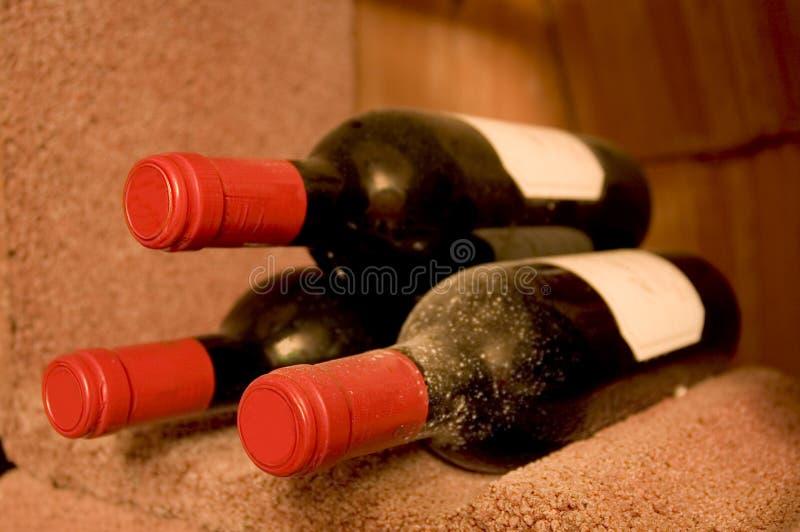 Tre bottiglie di vino fotografia stock